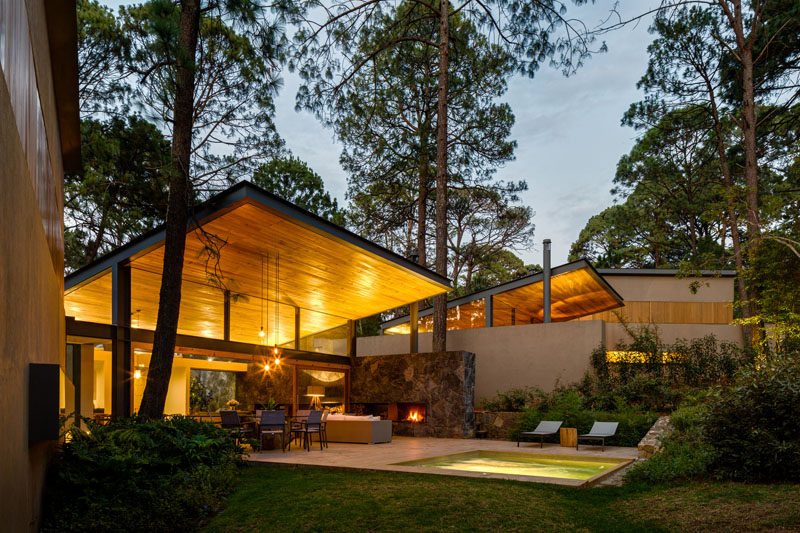 This home in Valle de Bravo, Mexico, was designed to allow the home owners to enjoy the tranquility of the surrounding forest of ancient pines and lush vegetation.