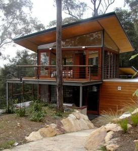 Проект современного коттеджа в холмистой местности