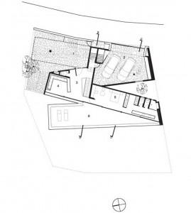 План нижнего уровня коттеджа с гаражем на две машины